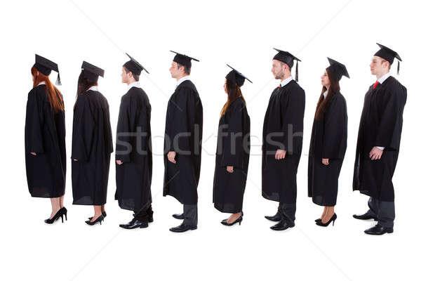 Graduate students standing in queue Stock photo © AndreyPopov