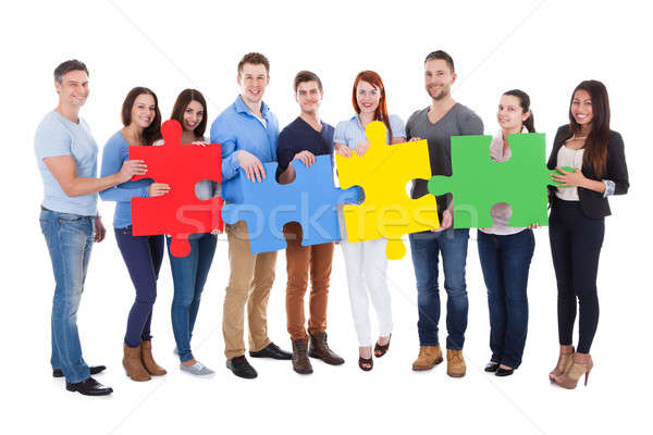 Stock photo: Group of people connecting puzzle pieces