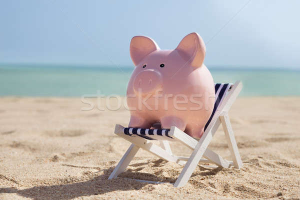 Piggy Bank With Deckchair Stock photo © AndreyPopov