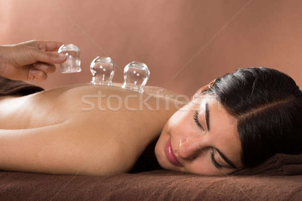 Woman Getting Cupping Treatment At Spa Stock photo © AndreyPopov