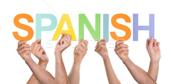 Many Persons Holding The Word Spanish Stock photo © AndreyPopov