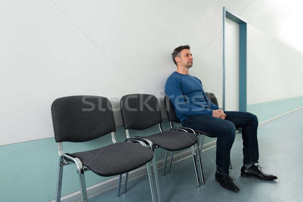 Man Sitting On Chair In Hospital Stock photo © AndreyPopov