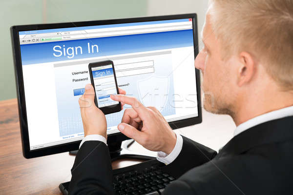 Businessman Signing In Email Account Stock photo © AndreyPopov