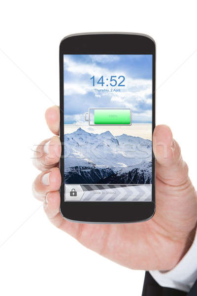 Hand With Mobile Phone Showing Charged Battery Stock photo © AndreyPopov