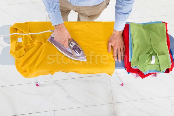 Man Ironing Yellow T-shirt Stock photo © AndreyPopov