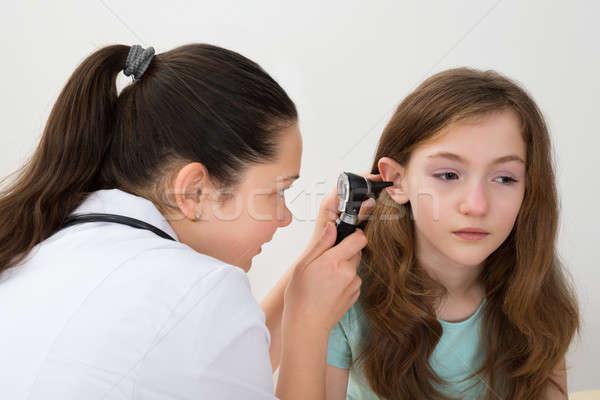 Doctor Examining Patient Ear With Otoscope Stock photo © AndreyPopov