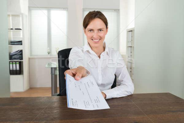Zakenvrouw aanbieden cheque kantoor gelukkig vergadering Stockfoto © AndreyPopov