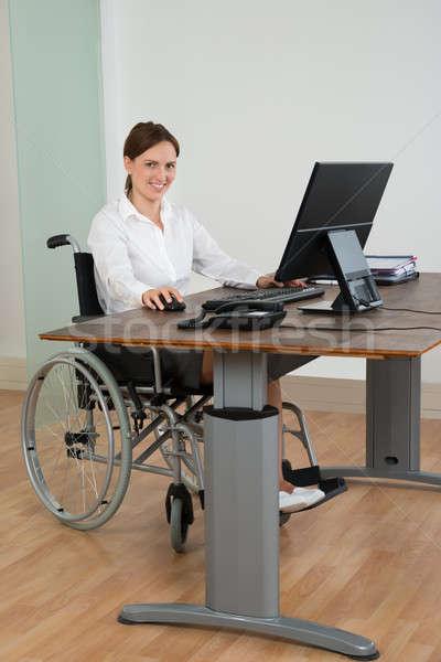 деловая женщина коляске рабочих компьютер счастливым сидят Сток-фото © AndreyPopov
