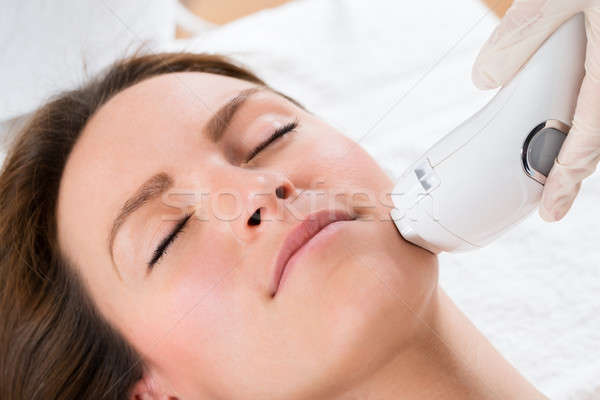 Beautician Giving Laser Epilation Treatment To Woman Face Stock photo © AndreyPopov
