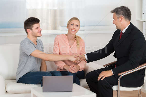 Consultant Shaking Hands To Couple Stock photo © AndreyPopov