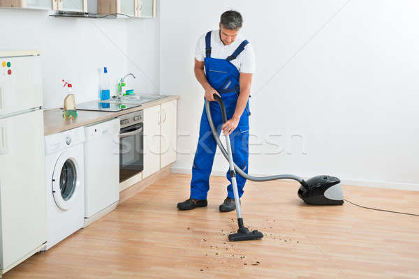 Worker Cleaning Floor With Vacuum Cleaner Stock photo © AndreyPopov
