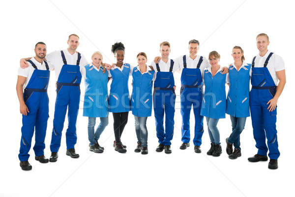 Confident Multiethnic Janitors Standing With Arms Around Stock photo © AndreyPopov