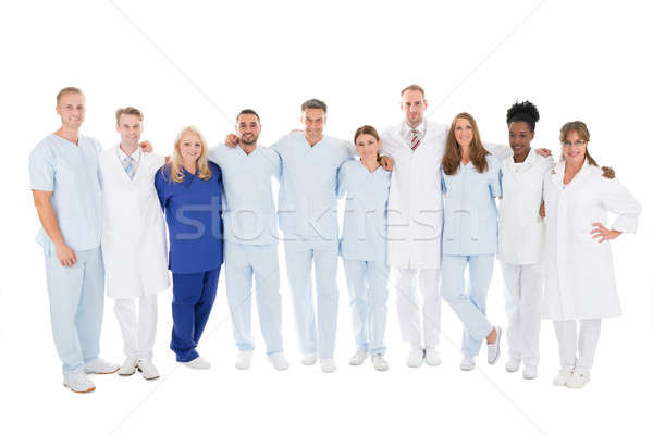 Confident Medical Team Standing With Arms Around Stock photo © AndreyPopov