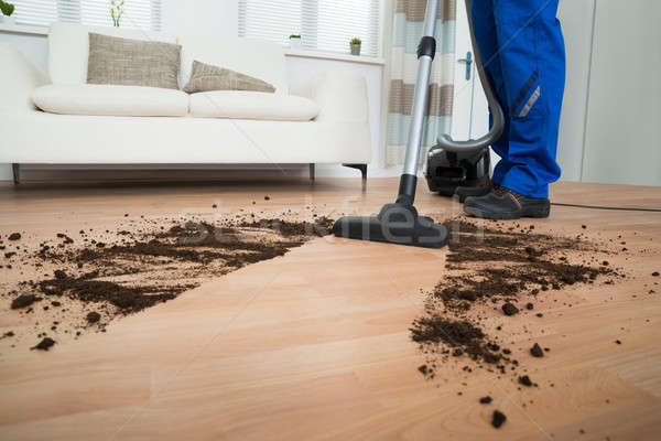 Male Worker Cleaning Floor With Vacuum Cleaner Stock photo © AndreyPopov