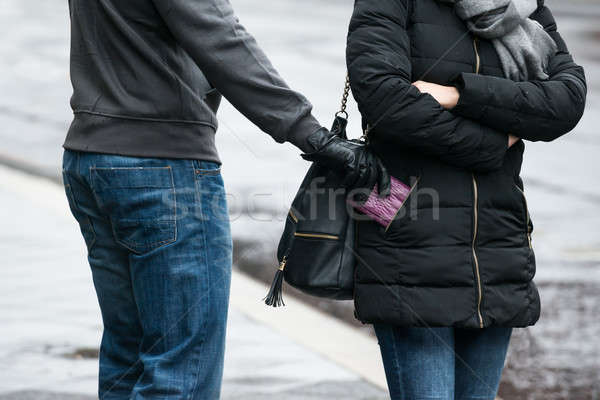 Robber Stealing Clutch From Woman's Jacket On Street Stock photo © AndreyPopov
