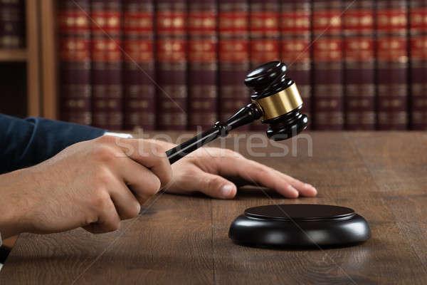 Judge Hitting Gavel At Desk Stock photo © AndreyPopov