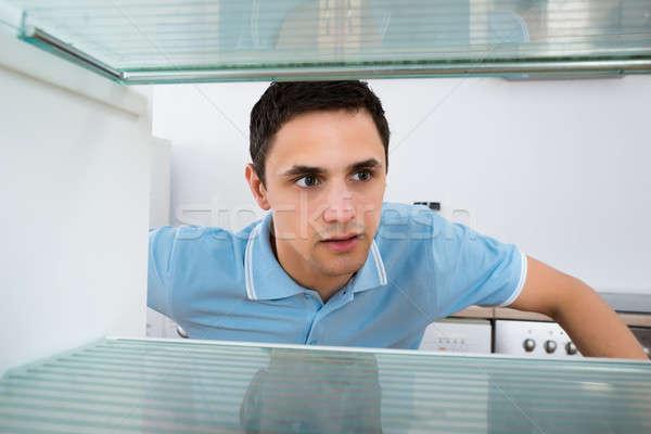 Shocked Man Looking Into Empty Refrigerator Stock photo © AndreyPopov