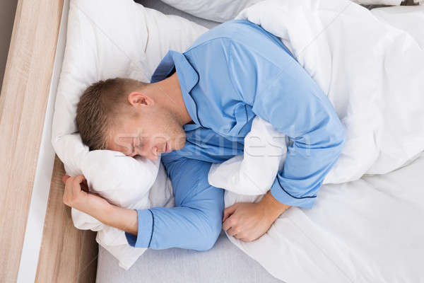 Stock photo: Young Man Sleeping At Home