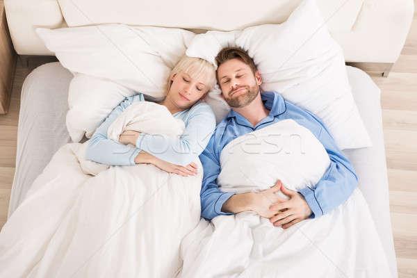 Stock photo: Young Couple Sleeping On Bed