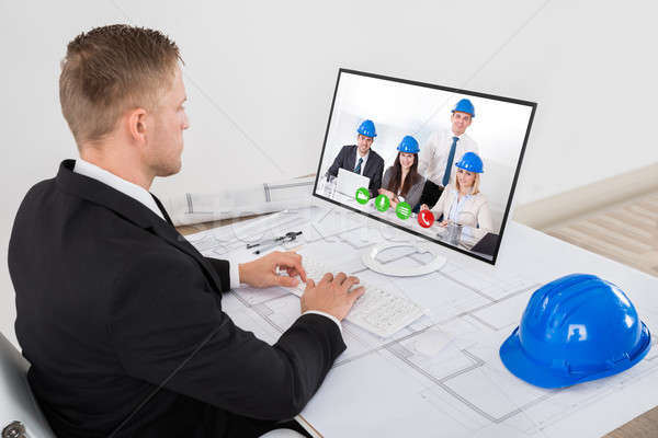 Stock photo: Architect Attending Video Conference In Office