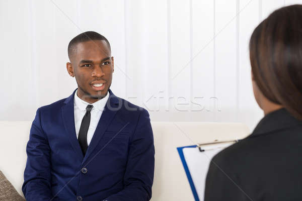 Young Man Talking With Psychologist About His Problems Stock photo © AndreyPopov
