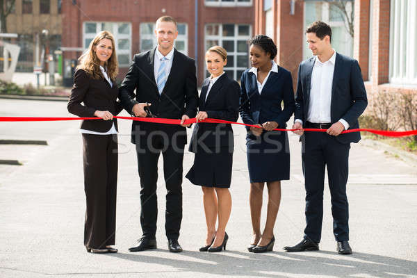 Businesspeople Cutting Ribbon Stock photo © AndreyPopov