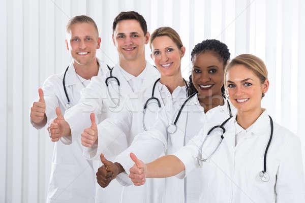 Orvosi háziorvos áll vonal csapat boldog Stock fotó © AndreyPopov