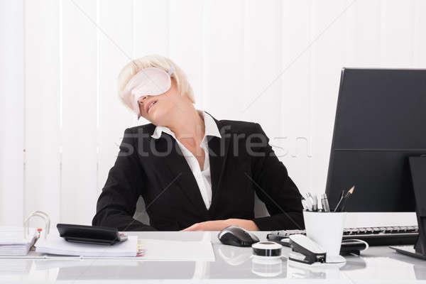 Businesswoman Wearing Eye Mask And Sleeping Stock photo © AndreyPopov