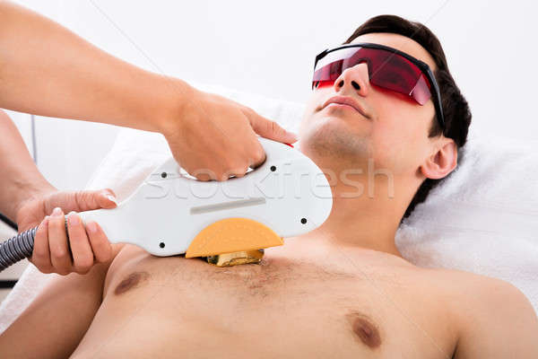 Therapist Giving Laser Epilation Treatment To Man Stock photo © AndreyPopov