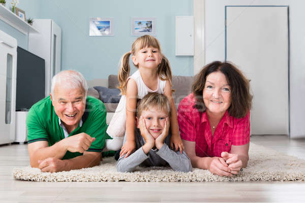 Portrait Of Multi Generation Family Lying On Carpet Stock photo © AndreyPopov