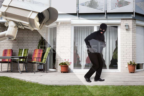 Security Camera Capturing Thief Running With Laptop Stock photo © AndreyPopov