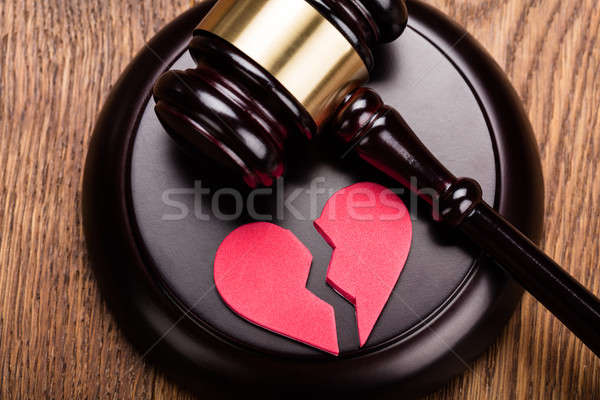 Red Broken Heart On Wooden Gavel Stock photo © AndreyPopov