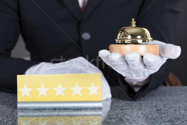 Pincér tart szolgáltatás harang közelkép kéz Stock fotó © AndreyPopov