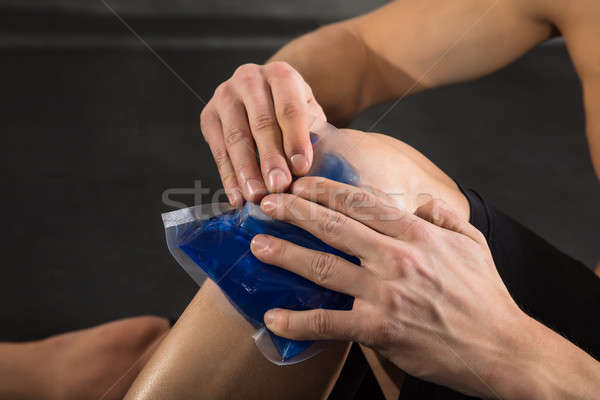 Person Applying Ice bag On Knee Stock photo © AndreyPopov
