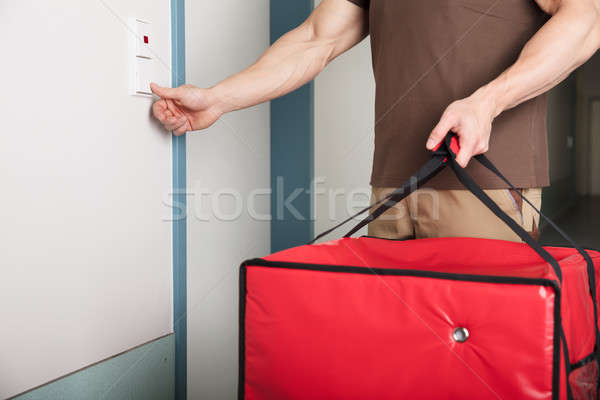 Pizza Delivery Man Ringing The Door Bell Stock photo © AndreyPopov