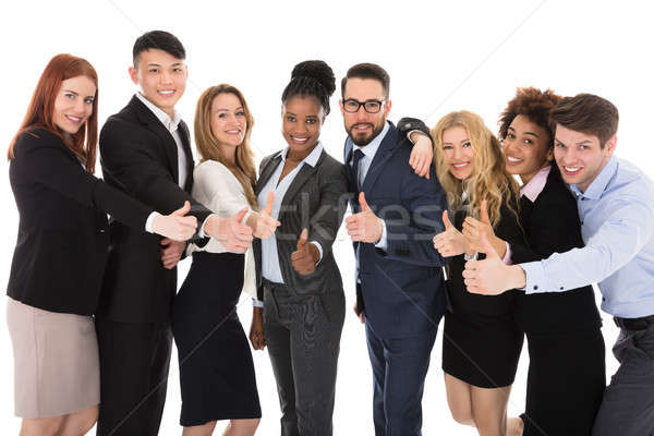 Group Of Multiracial Businesspeople Gesturing Thumbs Up Stock photo © AndreyPopov