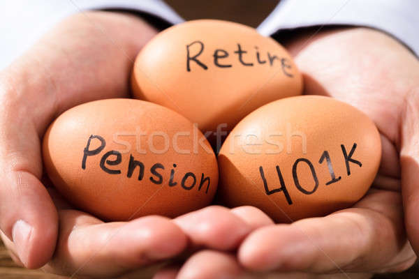 Human Hand With Egg Showing Pension And Retirement Text Stock photo © AndreyPopov