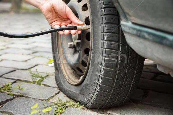 Measuring Car Tyre Pressure With Pressure Gauge Stock photo © AndreyPopov