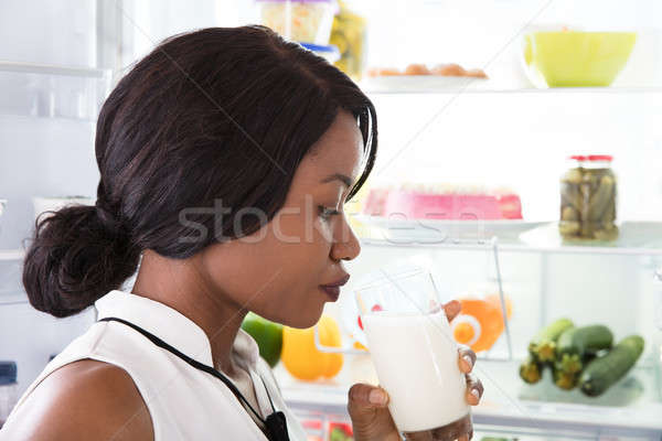 Woman Drinking Glass Of Milk Stock photo © AndreyPopov