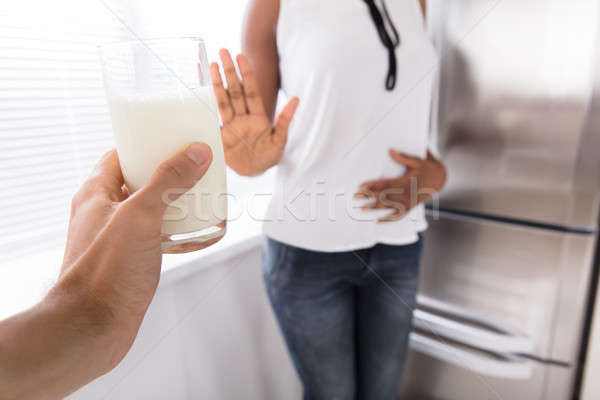 Stock photo: Woman Rejecting Glass Of Milk