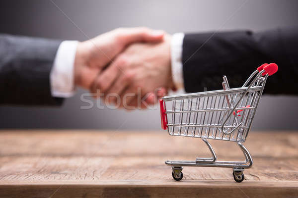 Close-up Of Shopping Cart On Wooden Table Stock photo © AndreyPopov