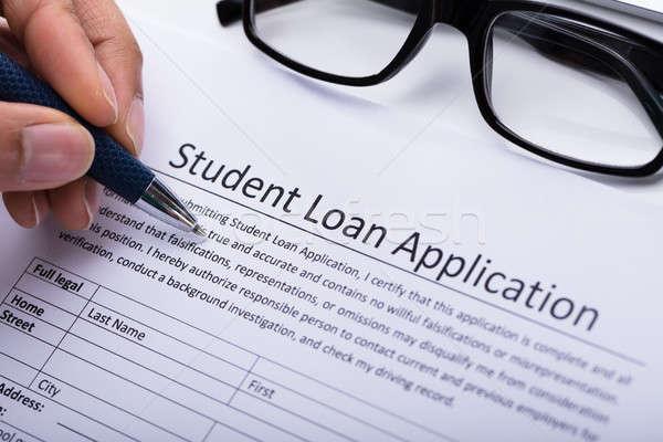 Persoon vulling student lening toepassing vorm Stockfoto © AndreyPopov