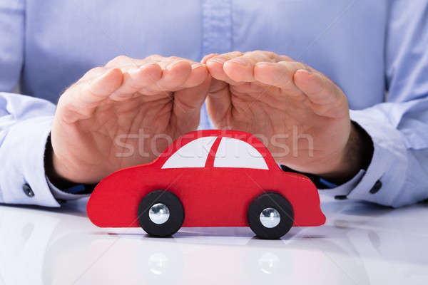 Person Protecting Red Car Stock photo © AndreyPopov