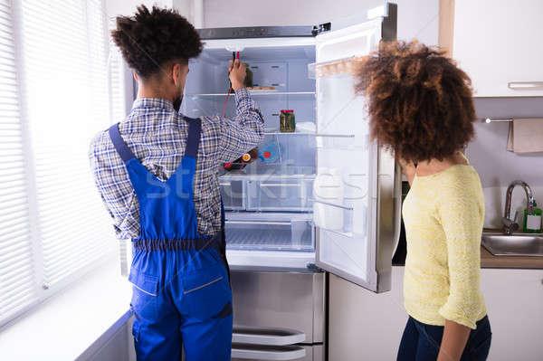 Repairman Checking Refrigerator With Digital Multimeter Stock photo © AndreyPopov