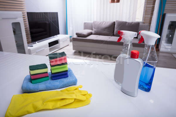 Different Cleaning Spray Bottles On White Desk Stock photo © AndreyPopov