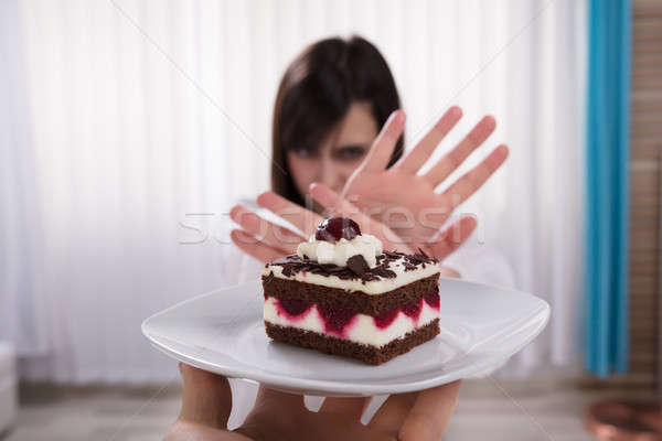 Woman Refusing Slice Of Cake Stock photo © AndreyPopov