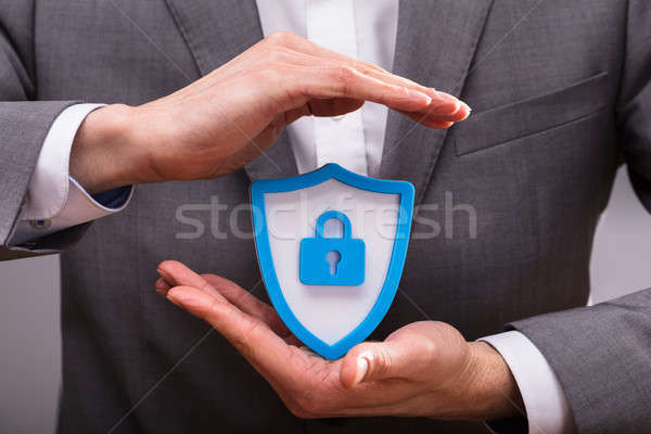 Mão humana escudo segurança ícone ver azul Foto stock © AndreyPopov