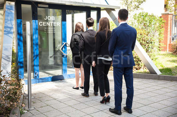 Businesspeople Standing At The Entrance Of Job Center Stock photo © AndreyPopov