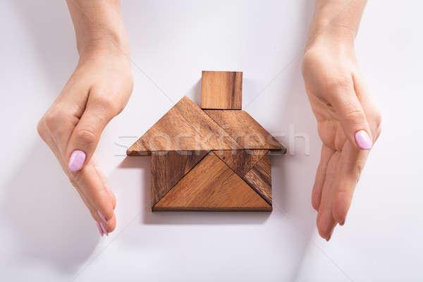 Nő ház fából készült puzzle közelkép kéz Stock fotó © AndreyPopov