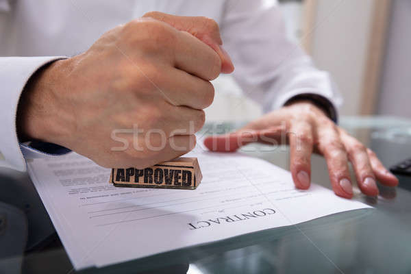 Businessman Stamping Approved On Contract Paper Stock photo © AndreyPopov